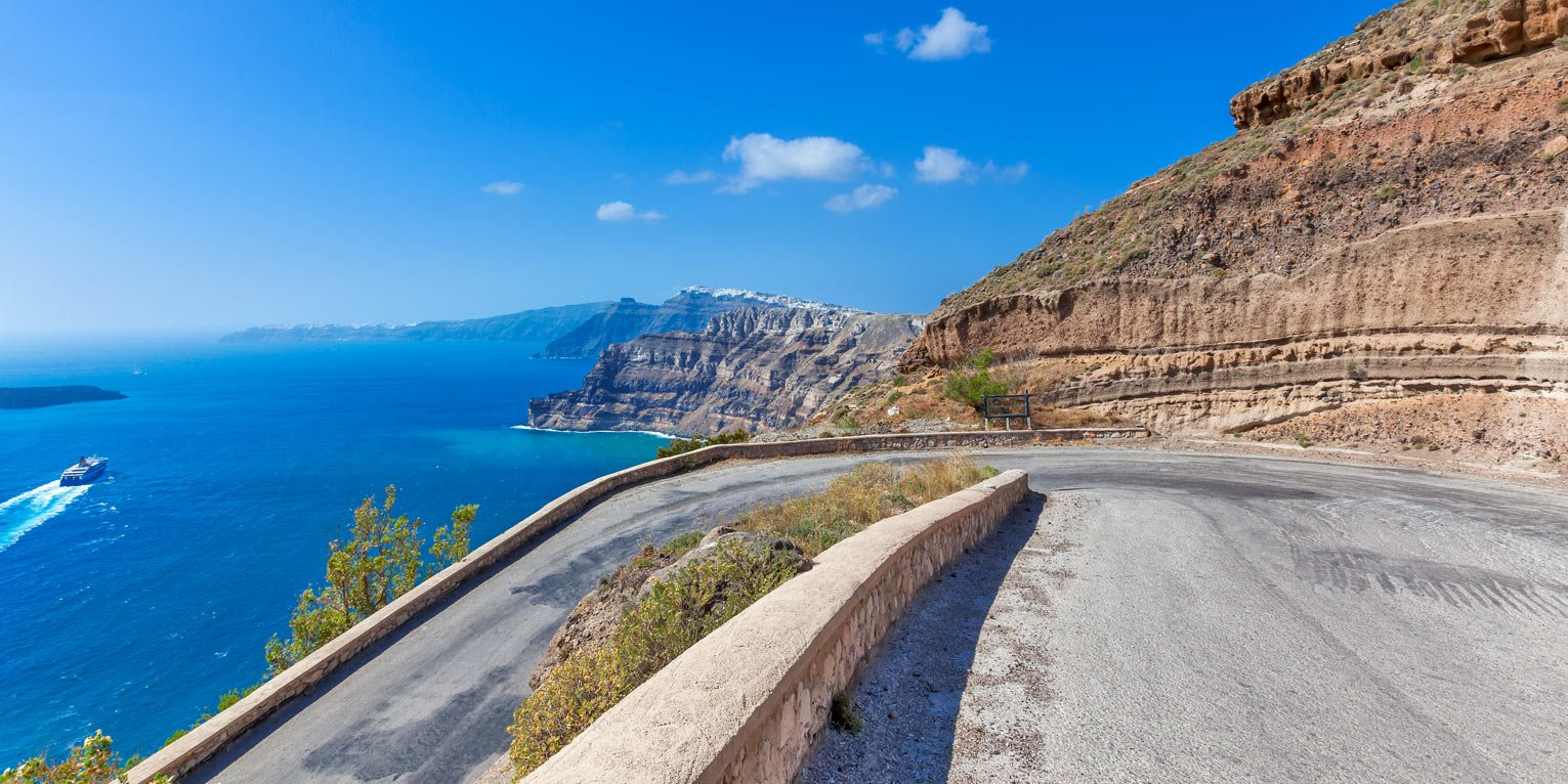 Drive in Santorini's roads with safety using a rented car from SantoriniCarHire.com